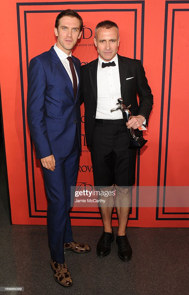 Dan Stevens poses with winner of the CFDA Menswear Designer of the Year Award Thom Browne at the 2013 CFDA Fashion Awards on June 3 2013 in New York...