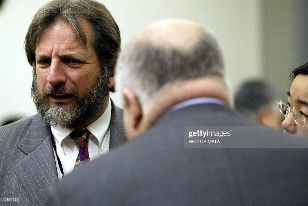 Dan Stormer (L), the attorney representing the plaintiffs in Doe vrs UNOCAL, confers with lawyers Paul Richardson (C) and Cornelia Dai (R) during a hearing break in Los Angeles 23 January 2004. Los Angeles Superior Court Judge Victoria Chaney ruled that the California-based oil company cannot be held liable for the alleged conduct of wholly owned units in the construction of a natural gas pipeline in Myanmar, formely known as Burma. Plaintiffs accused UNOCAL to be responsible for human right violations commited by Myanmar troops as they murdered, raped and enslaved villagers forcing them to work on the Yadana natural gas pipeline.