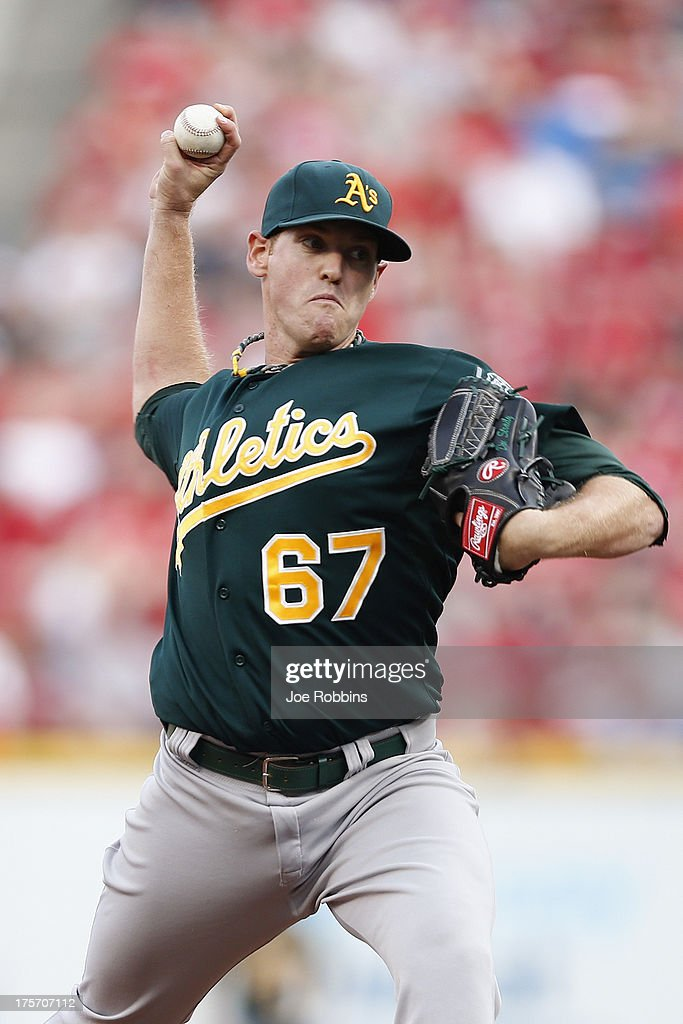 <a gi-track='captionPersonalityLinkClicked' href=/galleries/search?phrase=Dan+Straily&family=editorial&specificpeople=9615114 ng-click='$event.stopPropagation()'>Dan Straily</a> #67 of the Oakland Athletics pitches against the Cincinnati Reds during the game at Great American Ball Park on August 6, 2013 in Cincinnati, Ohio.