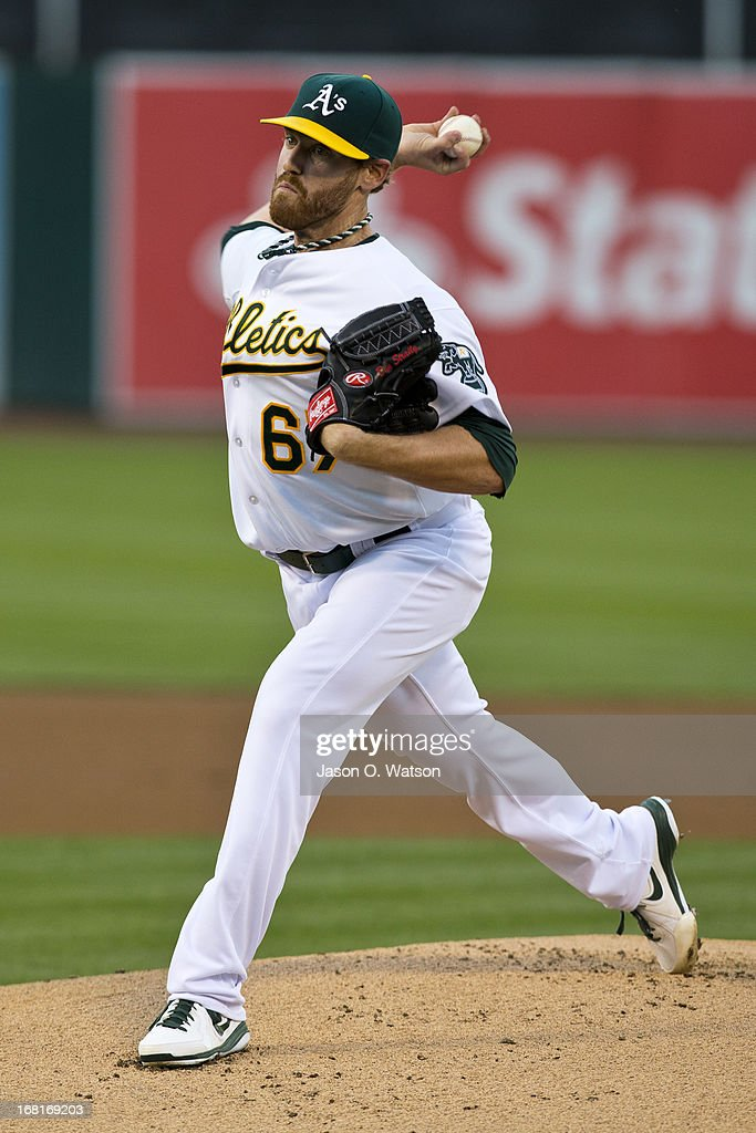 Dan Straily #67 of the Oakland Athletics pitches against the Los Angeles Angels of Anaheim during the first inning at O.co Coliseum on April 29, 2013 in Oakland, California. The Oakland Athletics defeated the Los Angeles Angels of Anaheim 10-8 in 19 innings.