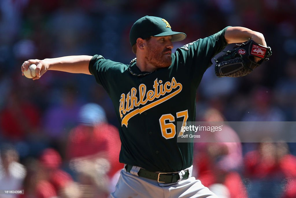 <a gi-track='captionPersonalityLinkClicked' href=/galleries/search?phrase=Dan+Straily&family=editorial&specificpeople=9615114 ng-click='$event.stopPropagation()'>Dan Straily</a> #67 of the Oakland Athletics pitches against the Los Angeles Angels of Anaheim in the second inning at Angel Stadium of Anaheim on September 25, 2013 in Anaheim, California.