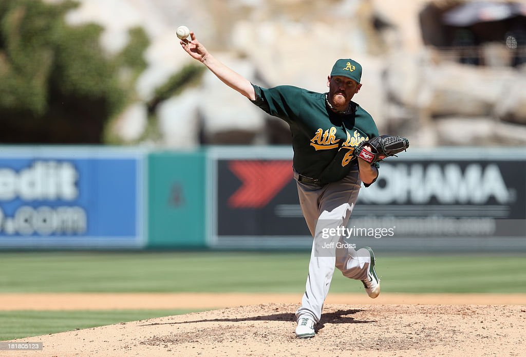 <a gi-track='captionPersonalityLinkClicked' href=/galleries/search?phrase=Dan+Straily&family=editorial&specificpeople=9615114 ng-click='$event.stopPropagation()'>Dan Straily</a> #67 of the Oakland Athletics pitches against the Los Angeles Angels of Anaheim in the fourth inning at Angel Stadium of Anaheim on September 25, 2013 in Anaheim, California.