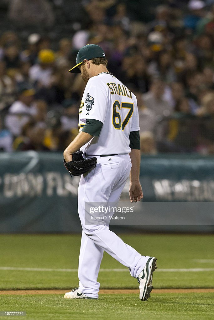 Dan Straily #67 of the Oakland Athletics returns to the dugout after being relieved against the Los Angeles Angels of Anaheim during the fifth inning at O.co Coliseum on April 29, 2013 in Oakland, California.