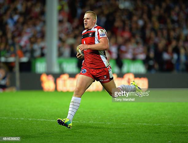 Dan Thomas of Gloucester Rugby truns in to score a try against Bath Rugby during the Singha Premiership Rugby 7s Series Gloucester at Kingsholm...