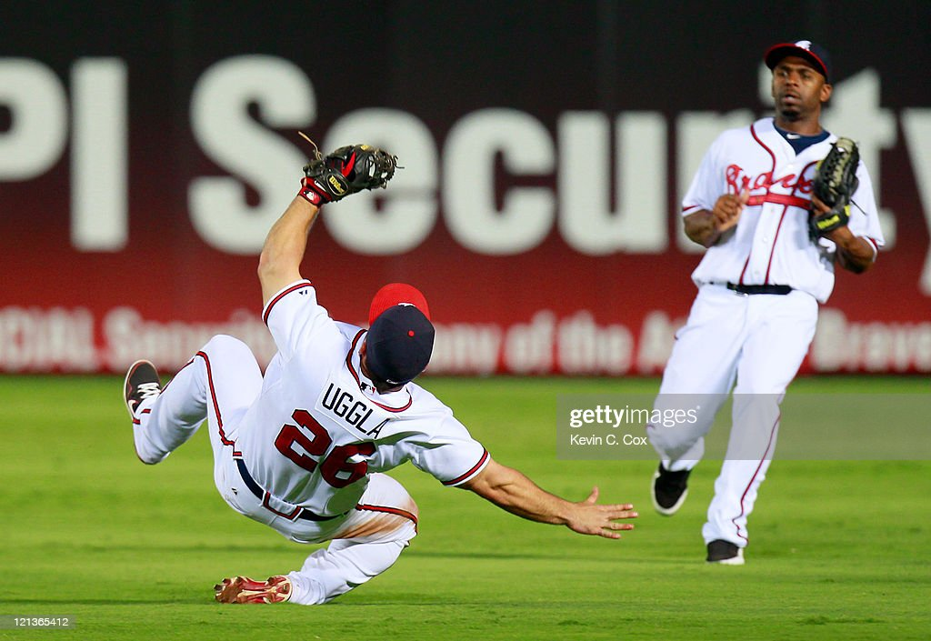 <a gi-track='captionPersonalityLinkClicked' href=/galleries/search?phrase=Dan+Uggla&family=editorial&specificpeople=542208 ng-click='$event.stopPropagation()'>Dan Uggla</a> #26 of the Atlanta Braves catches a pop fly by Orlando Cabrera #43 of the San Francisco Giants in the ninth inning at Turner Field on August 18, 2011 in Atlanta, Georgia.