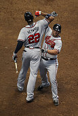 Dan Uggla of the Atlanta Braves celebrates a solo home run in the 8th inning with teammate Jason Heyward against the Milwaukee Brewers during the...