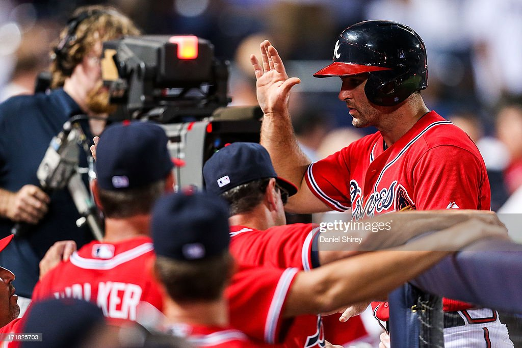 <a gi-track='captionPersonalityLinkClicked' href=/galleries/search?phrase=Dan+Uggla&family=editorial&specificpeople=542208 ng-click='$event.stopPropagation()'>Dan Uggla</a> #26 of the Atlanta Braves celebrates after scoring in the eighth inning against the Arizona Diamondbacks at Turner Field on June 28, 2013 in Atlanta, Georgia.