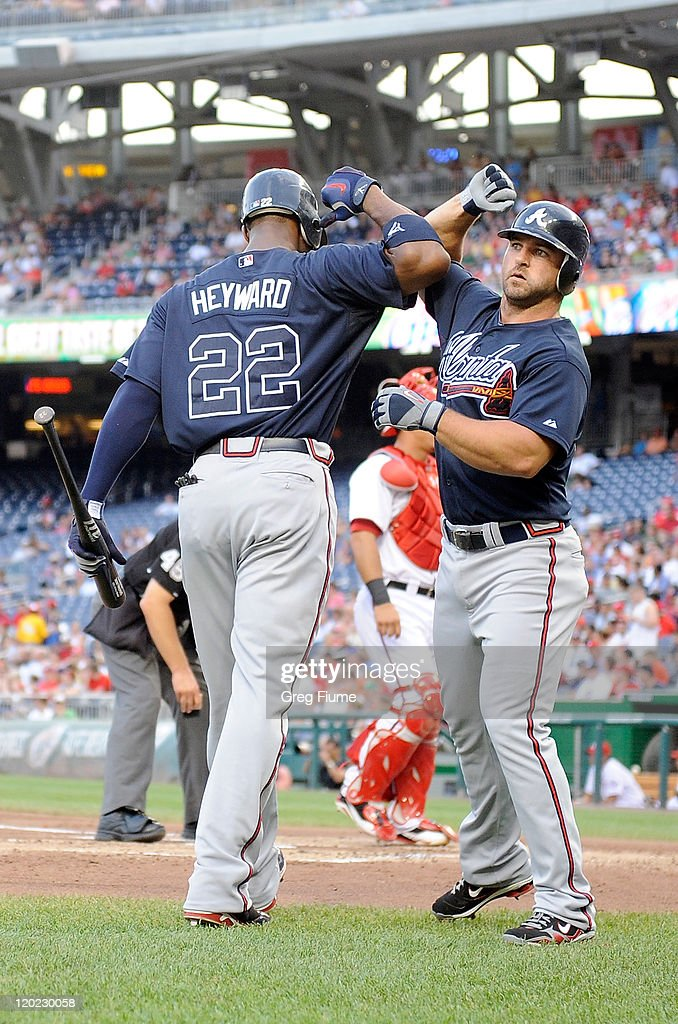 <a gi-track='captionPersonalityLinkClicked' href=/galleries/search?phrase=Dan+Uggla&family=editorial&specificpeople=542208 ng-click='$event.stopPropagation()'>Dan Uggla</a> #26 of the Atlanta Braves celebrates with <a gi-track='captionPersonalityLinkClicked' href=/galleries/search?phrase=Jason+Heyward&family=editorial&specificpeople=5043351 ng-click='$event.stopPropagation()'>Jason Heyward</a> #22 after hitting a home run in the second inning against the Washington Nationals at Nationals Park on August 1, 2011 in Washington, DC.
