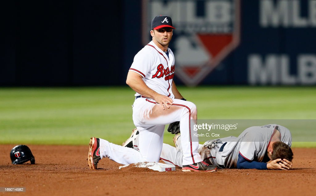 <a gi-track='captionPersonalityLinkClicked' href=/galleries/search?phrase=Dan+Uggla&family=editorial&specificpeople=542208 ng-click='$event.stopPropagation()'>Dan Uggla</a> #26 of the Atlanta Braves checks on <a gi-track='captionPersonalityLinkClicked' href=/galleries/search?phrase=Trevor+Plouffe&family=editorial&specificpeople=5722348 ng-click='$event.stopPropagation()'>Trevor Plouffe</a> #24 of the Minnesota Twins after they collided at second base in the 10th inning at Turner Field on May 21, 2013 in Atlanta, Georgia.