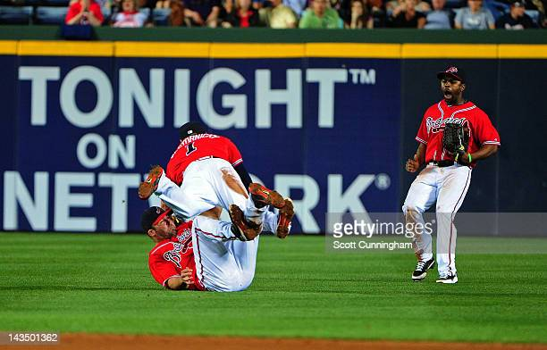 Dan Uggla of the Atlanta Braves collides with Tyler Pastornicky after making a diving catch against the Pittsburgh Pirates at Turner Field on April...