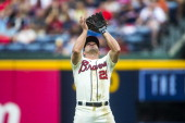 Dan Uggla of the Atlanta Braves fields a ball against the Miami Marlins at Turner Field on September 1 2013 The Marlins won 70