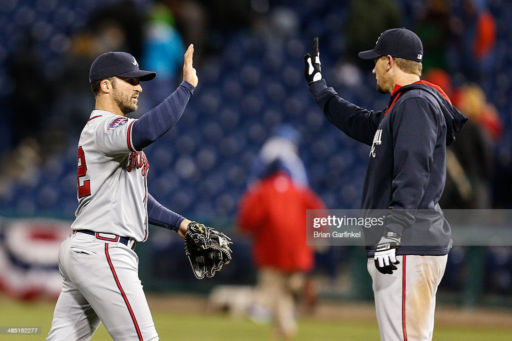 <a gi-track='captionPersonalityLinkClicked' href=/galleries/search?phrase=Dan+Uggla&family=editorial&specificpeople=542208 ng-click='$event.stopPropagation()'>Dan Uggla</a> of the Atlanta Braves high fives a teammate after the game against the Philadelphia Phillies at Citizens Bank Park on April 16, 2014 in Philadelphia, Pennsylvania. All uniformed team members are wearing jersey number 42 in honor of Jackie Robinson Day. The Braves won 1-0.