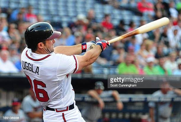 Dan Uggla of the Atlanta Braves hits a first inning three run home run against the Minnesota Twins at Turner Field on May 20 2013 in Atlanta Georgia