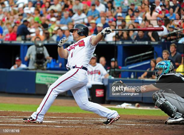Dan Uggla of the Atlanta Braves hits a three run home run in the 4th inning against the Florida Marlins at Turner Field on July 30 2011 in Atlanta...