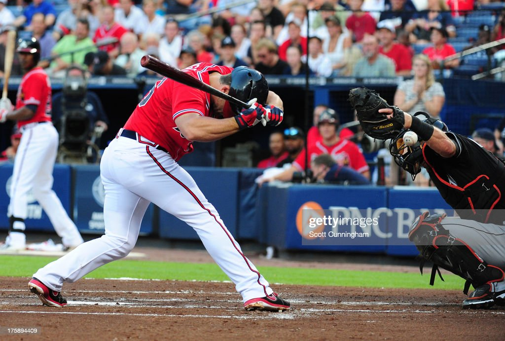 <a gi-track='captionPersonalityLinkClicked' href=/galleries/search?phrase=Dan+Uggla&family=editorial&specificpeople=542208 ng-click='$event.stopPropagation()'>Dan Uggla</a> #26 of the Atlanta Braves is hit by a first-inning pitch thrown by Jacob Turner (not pictured) of the Miami Marlins at Turner Field on August 9, 2013 in Atlanta, Georgia.