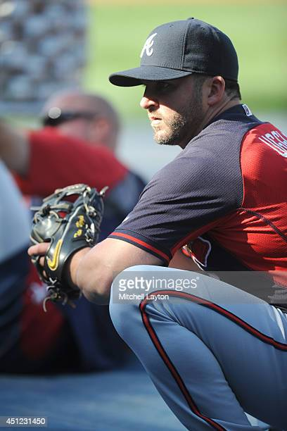 Dan Uggla of the Atlanta Braves looks on before a baseball game against the Atlanta Braves on June 20 2014 at Nationals Park in Washington DC The...