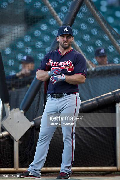 Dan Uggla of the Atlanta Braves looks on during batting practice before the game against the San Francisco Giants at ATT Park on May 12 2014 in San...