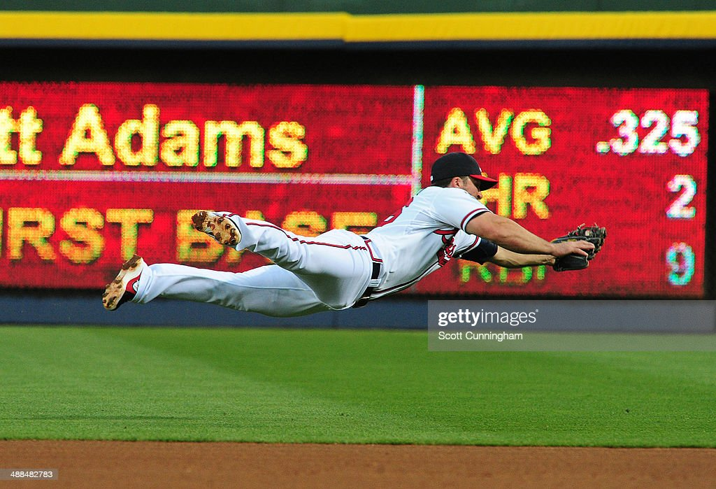 <a gi-track='captionPersonalityLinkClicked' href=/galleries/search?phrase=Dan+Uggla&family=editorial&specificpeople=542208 ng-click='$event.stopPropagation()'>Dan Uggla</a> #26 of the Atlanta Braves makes a diving stop of a 4th inning ground ball against the St. Louis Cardinals at Turner Field on May 6, 2014 in Atlanta, Georgia.
