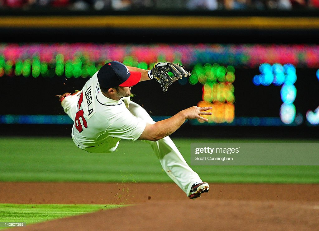 <a gi-track='captionPersonalityLinkClicked' href=/galleries/search?phrase=Dan+Uggla&family=editorial&specificpeople=542208 ng-click='$event.stopPropagation()'>Dan Uggla</a> #26 of the Atlanta Braves makes a throw against the Milwaukee Brewers at Turner Field on April 14, 2012 in Atlanta, Georgia.