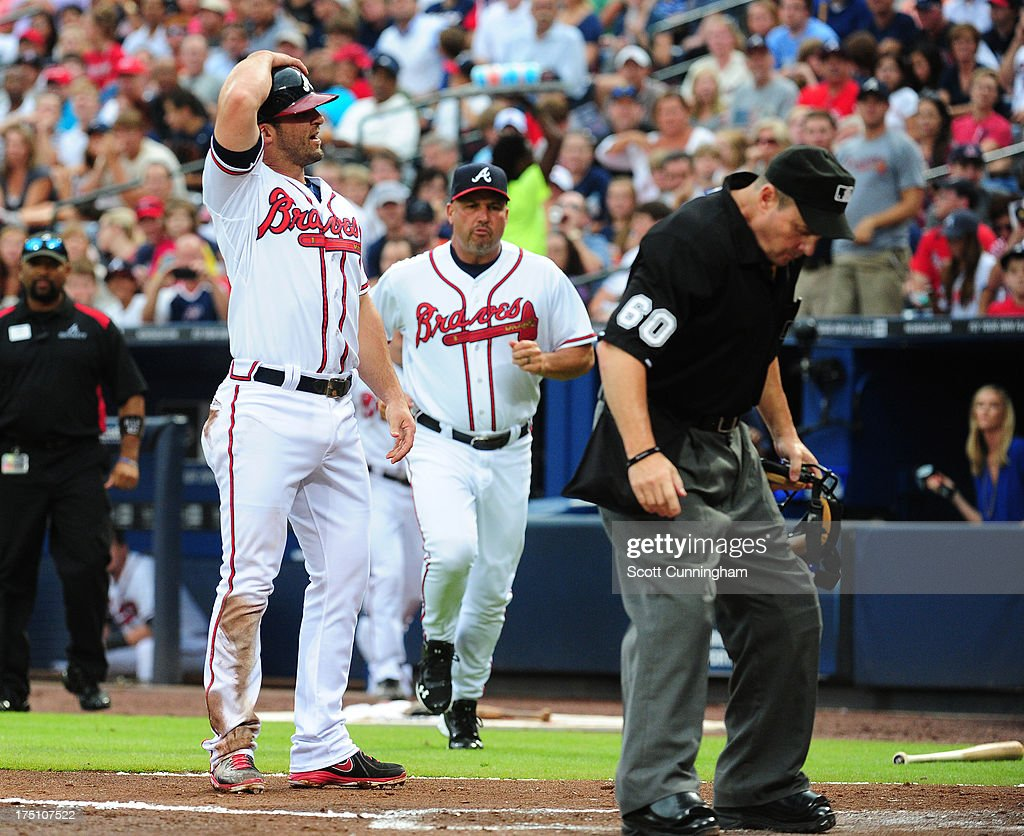 <a gi-track='captionPersonalityLinkClicked' href=/galleries/search?phrase=Dan+Uggla&family=editorial&specificpeople=542208 ng-click='$event.stopPropagation()'>Dan Uggla</a> #26 of the Atlanta Braves reacts after being called out at home by Umpire Marty Foster during the game against the Colorado Rockies at Turner Field on July 31, 2013 in Atlanta, Georgia. Braves Manager <a gi-track='captionPersonalityLinkClicked' href=/galleries/search?phrase=Fredi+Gonzalez&family=editorial&specificpeople=686896 ng-click='$event.stopPropagation()'>Fredi Gonzalez</a> runs out on to the field to dispute the call.