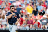 Dan Uggla of the Atlanta Braves tosses his helmet after striking out in the first inning of the game against the Philadelphia Phillies at Citizens...