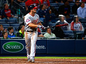 Dan Uggla of the Washington Nationals hits a threerun homer in the ninth inning to score Jose Lobaton and Danny Espinosa against the Atlanta Braves...