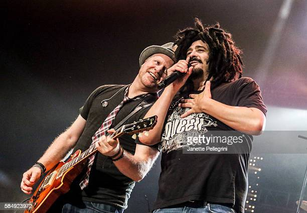 Dan Vickrey and Adam Duritz of Counting Crows perform in concert at Nikon at Jones Beach Theater on July 31 2016 in Wantagh New York