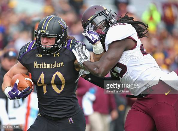 Dan Vitale of the Northwestern Wildcats fights off De'Vondre Campbell of the Minnesota Golden Gophers at Ryan Field on October 3 2015 in Evanston...