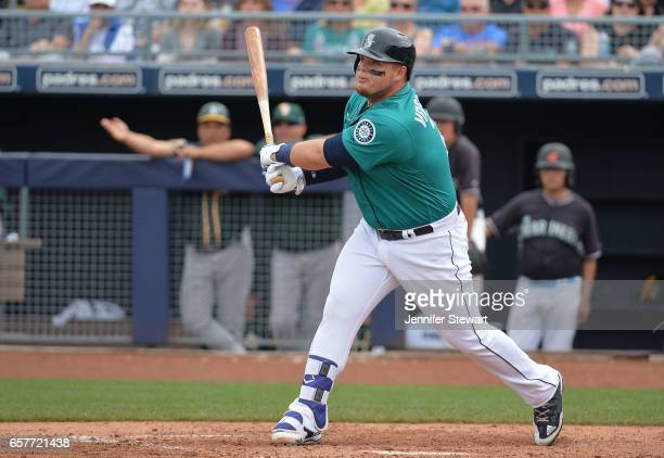 Dan Vogelbach of the Seattle Mariners hits a double against the Oakland Athletics during the spring training game at Peoria Stadium on March 5 2017...