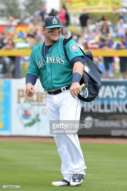 Dan Vogelbach of the Seattle Mariners smiles while arriving to the spring training game against the Oakland Athletics at Peoria Stadium on March 5...