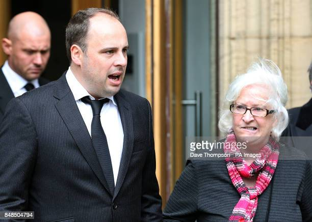 Dan Waddell left leaves Pusdey Parish Church in West Yorkshire with the wife of former darts commentator Sid Waddell Irene following his fathers...