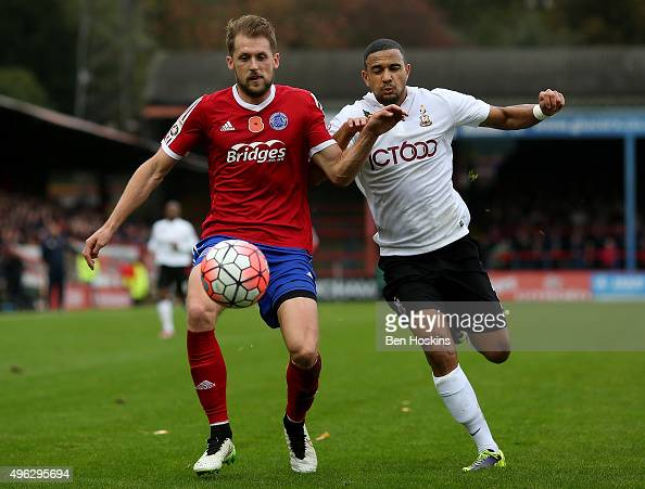 Dan Walker of Aldershot holds off the challenge of James Meridith of Bradford during The Emirates FA Cup First Round match between Aldershot Town and...