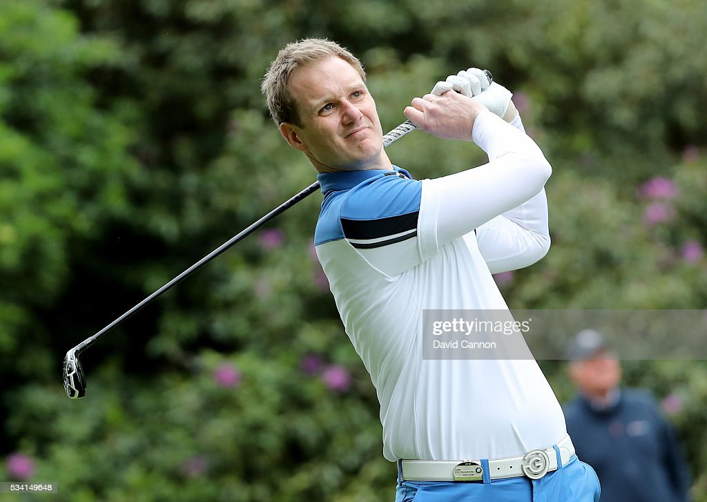 Dan Walker tees off during the Pro-Am prior to the BMW PGA Championship at Wentworth on May 25, 2016 in Virginia Water, England.