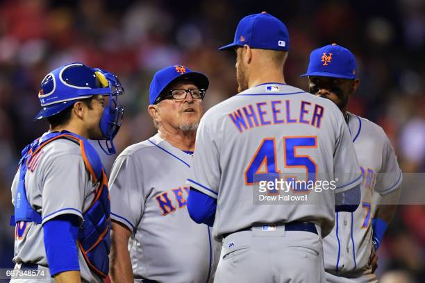 Dan Warthen of the New York Mets talks with Zack Wheeler as Travis d'Arnaud and Jose Reyes look on in the sixth inning during the game against the...