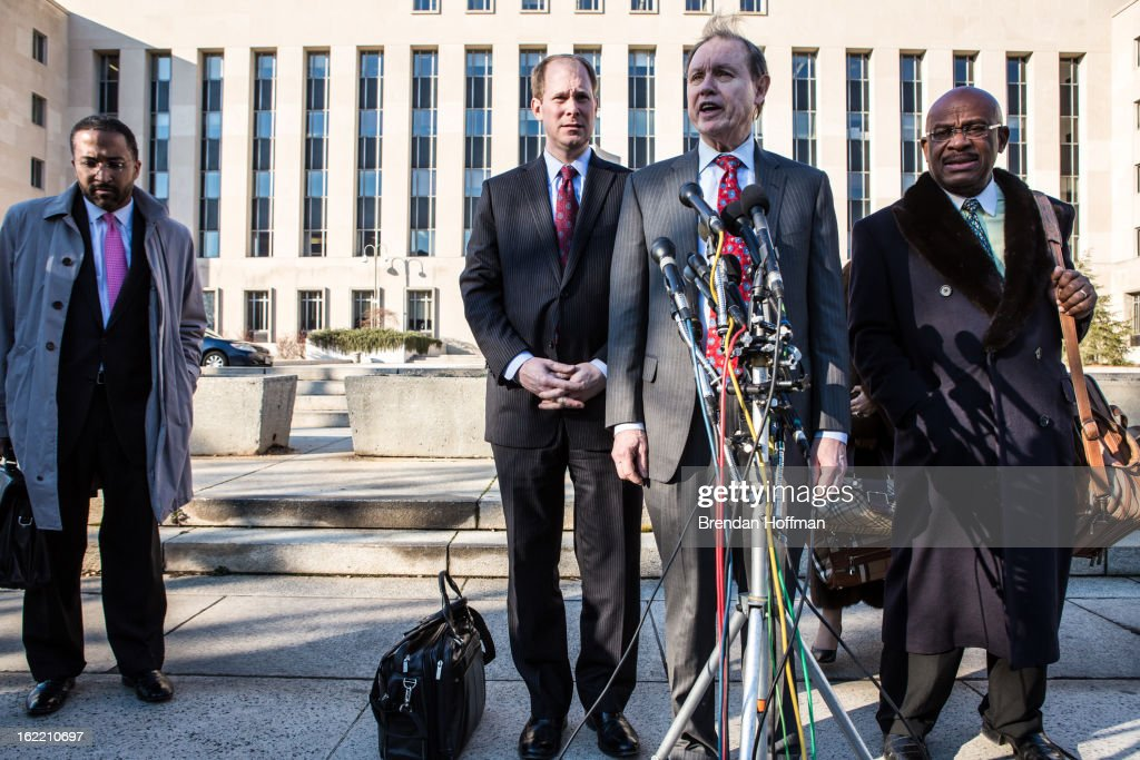 Dan Webb (3rd L), the attorney for former Chicago alderman Sandi Jackson, talks to reporters outside the U.S. District Court for the District of Columbia on February 20, 2013 in Washington, DC. Jackson and her husband, former Congressman Jesse Jackson, Jr., plead guilty to federal charges of spending more than $750,000 in campaign cash on personal expenses.