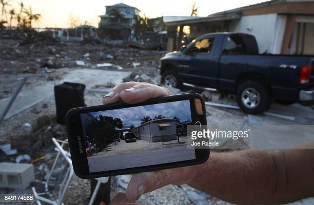Dan Weeks shows a picture of what his mobile home looked like on the now empty lot before hurricane Irma passed through the area destroying it on...