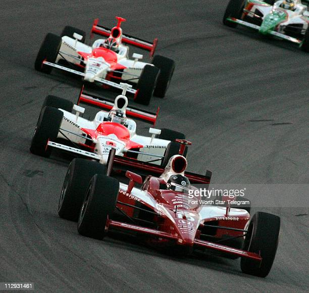 Dan Weldon leads Sam Hornish Jr and Helio Castroneves during the early laps of the IRL's IndyCar Bombardier Learjet 500 at Texas Motor Speedway...
