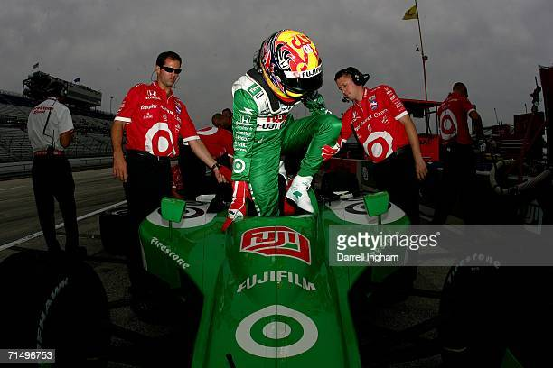 Dan Wheldon climbs from the Target Ganassi Racing Fujifilm Dallara Honda during practice for the IRL IndyCar Series ABC Supply Company AJFoyt 225 on...