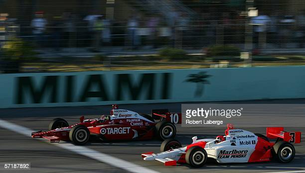 Dan Wheldon driver of the Target Chip Ganassi Racing Honda Dallara beats Helio Castroneves driver of the Marlboro Team Penke Dallara Honda to the...