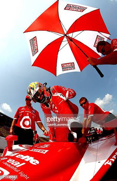 Dan Wheldon driver of the Target Ganassi Racing Dallara Honda climbs aboard during qualifying for the IRL Indycar Series Firestone Indy 400 on July...