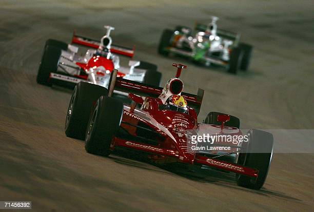 Dan Wheldon driver of the Target Ganassi Racing Dallara Honda leads Sam Hornish Jr driver of the Marlboro Team Penske Dallara Honda and Tony Kanaan...