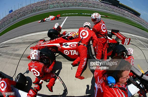 Dan Wheldon driver of the Target Ganassi Racing Dallara Honda makes a tire and fuel stop during the IRL Indycar Series Kansas Lottery Indy 300 on...