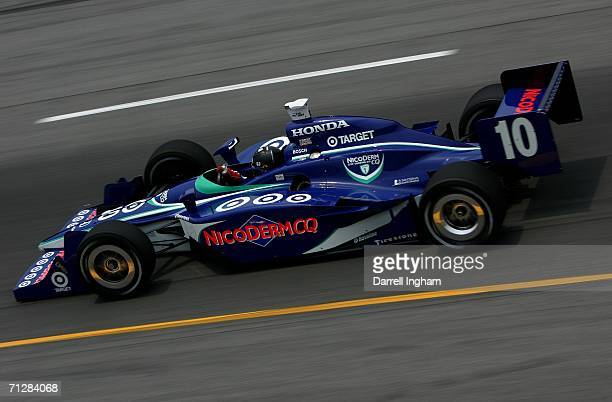 Dan Wheldon drives the Target Ganassi Racing Nicoderm Dallara Honda during practice for the IRL IndyCar Series SunTrust Indy Challenge on June 23...