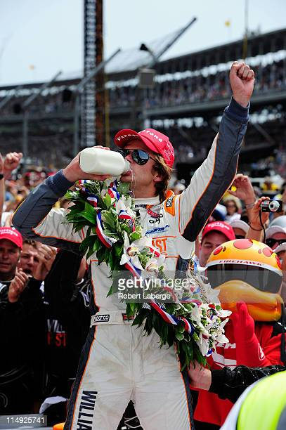 Dan Wheldon of England driver of the William RastCurb/Big Machine Dallara Honda drinks milk as he celebrates in victory lane after winning the IZOD...