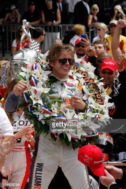 Dan Wheldon of England driver of the William RastCurb/Big Machine Dallara Honda celebrates in victory lane after winning the IZOD IndyCar Series...