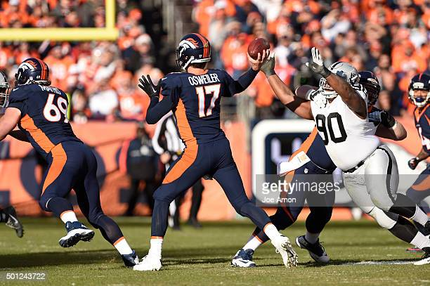 Dan Williams of the Oakland Raiders puts pressure on Brock Osweiler of the Denver Broncos in the first quarter The Broncos played the Oakland Raiders...