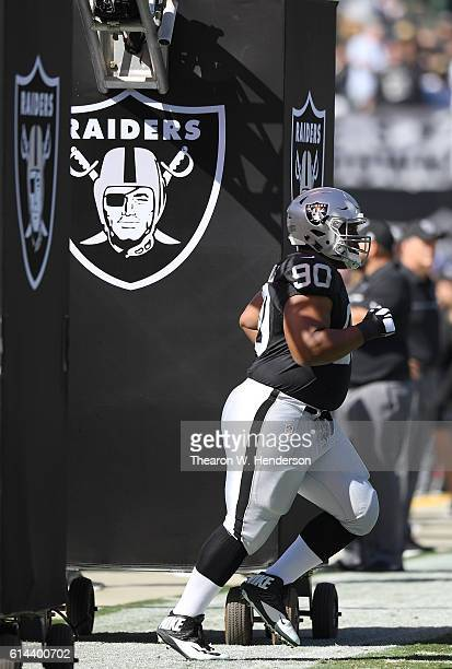 Dan Williams of the Oakland Raiders runs onto the field during player introduction prior to playing the San Diego Chargers in an NFL football game at...