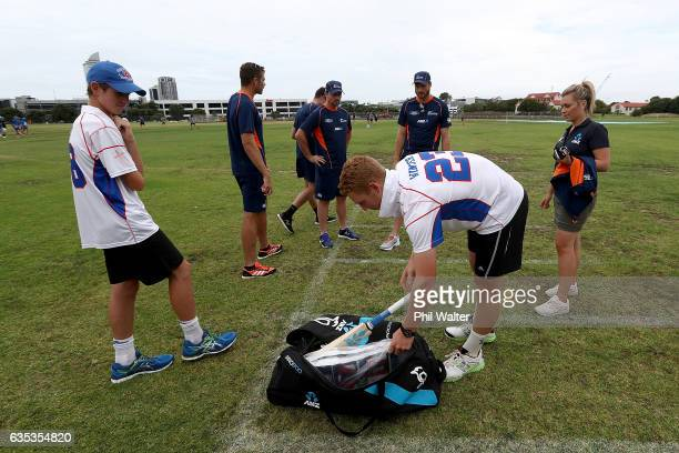 Dan Winter and Jordan Gatler of Rosmini College look over the ultimate family cricket set up as Martin Guptill Tim Southee Colin Munro and Mitch...