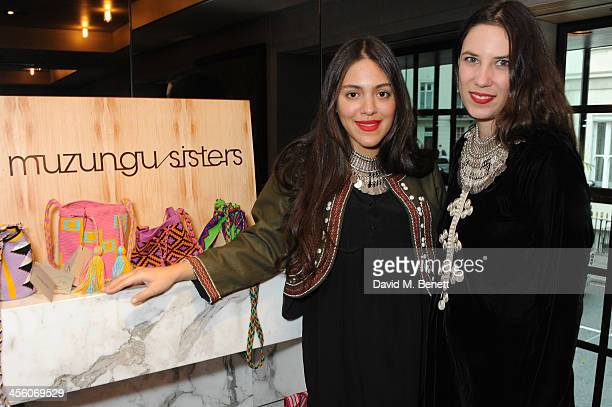 Dana Alikhani and Tatiana Santo Domingo attend a party organised by the fashion brand Muzungu sisters at Pont St restaurant on December 13 2013 in...