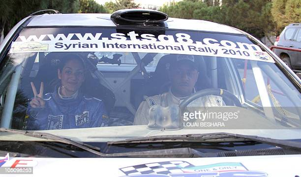Dana Assaf Lebanese codriver to Kwuait's Mezher alTnak are seen at the finish line of the 10th Syrian International Rally round six of the FIA Middle...
